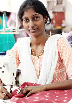 Kalaivani stitches a bag