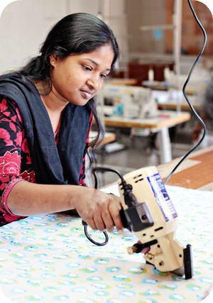 Sumitra tries out the new cutting machine